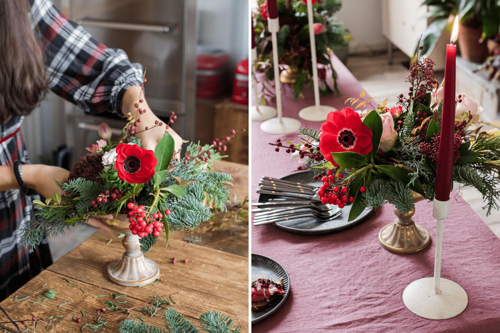 Carolina che mette a punto le composizioni di anemone rosso, bacche, rose e abete